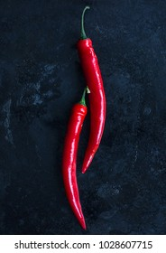 Red chilli peppers on a dark background