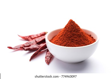 Red Chilly or Mirchi with Powder in a bowl over moody background, selective focus