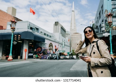 red china flag on the building flying in wind. chinese tourist visit sightseeing chinatown in san francisco usa. Beautiful view of business center in downtown with transamerica pyramid building.