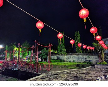 Red chinese lampion lanterns in the park at night