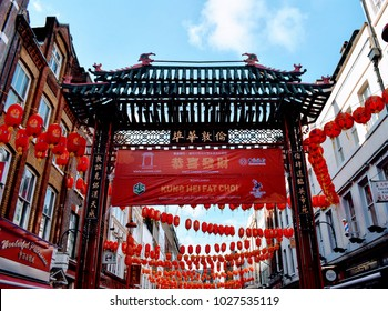 Red Chinese lanterns and gate in China Town, London, decorating the streets on Chinese New Years Celebrations, February 2018.