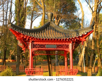 A red Chinese pavilion at the Artificial Lake national park, Tirana, Albania