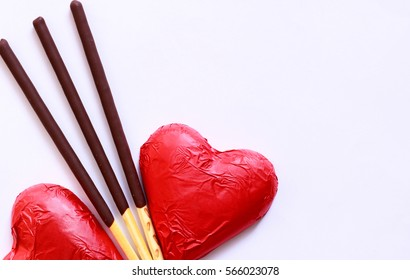 Red chocolate heart with biscuit stick coated with chocolate flavour confectionery.Valentine chocolates