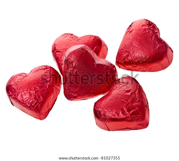 Red chocolate hearts candies on white