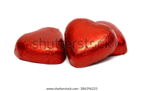 Red chocolate hearts isolated on white