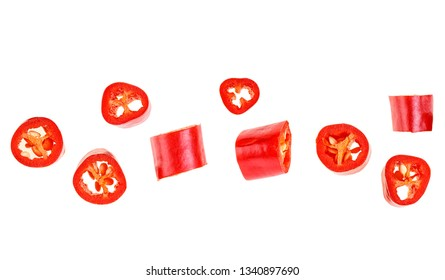 Red chopped chili peppers on white background. Top view.