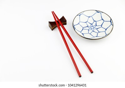 red Chopsticks and ceramic plate on White background