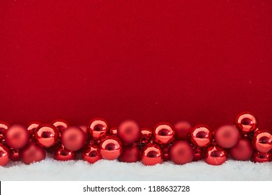Red christmas background with baubles for greeting card