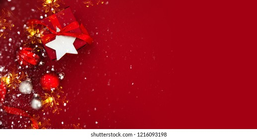Red Christmas background with xmas gifts. Merry Сhristmas greeting card. Winter season holiday background. Happy New Year.