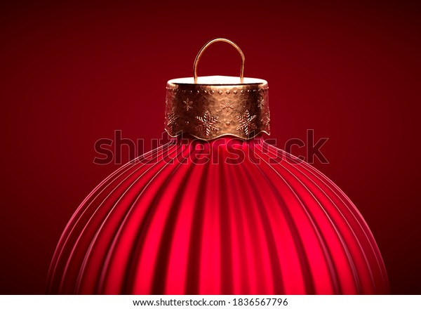 Red Christmas ball. Close up of vertically striped bauble against red burgundy background. Christmas decoration, festive atmosphere concept.