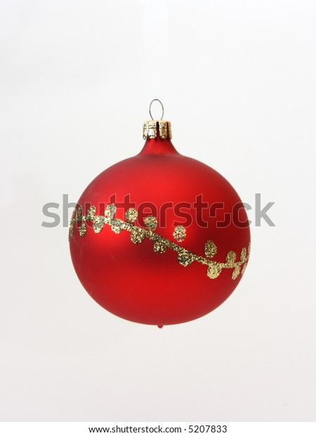 Red christmas ball decorated with gold on white background