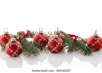 red christmas ball decorations and fir tree on white background
