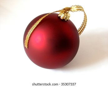 Red Christmas ball with gold ribbon, isolated on white