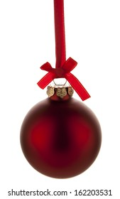 Red christmas ball hanging with ribbon on white background