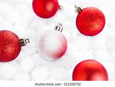 Red christmas ball on snow balls on white background