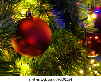 Red Christmas ball on Christmas trees with little lights