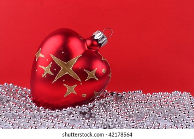 Red Christmas ball on white and red background