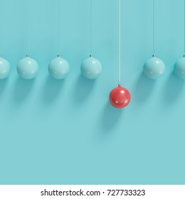 Red christmas ball Ornaments among blue ball hanging on white background. minimal christmas concept.