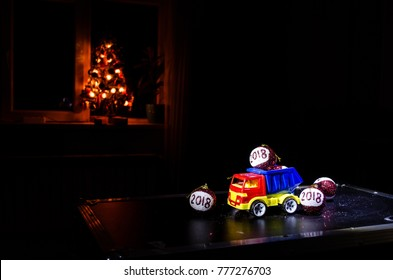 Red christmas balls with 2018 number and Santa Clause hat on natural snow background .Happy new year 2018 concept.Copy space.Selective focus. Dark Foggy background