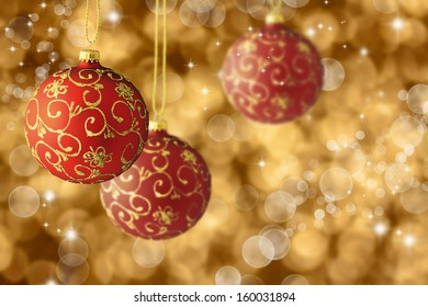 Red Christmas balls with golden fantasy background