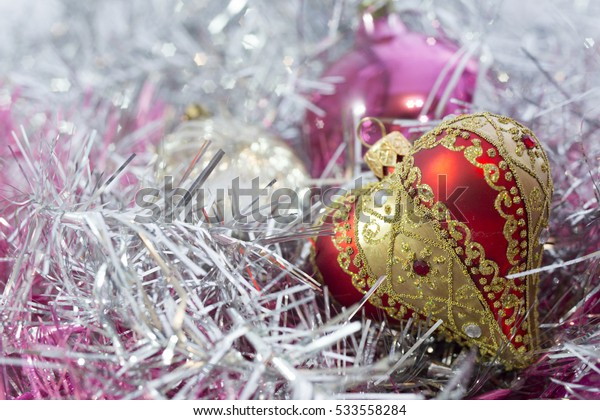 red Christmas balls and on abstract background