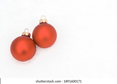Red Christmas balls on the snow. There is a place for text .Christmas happy new year concept.