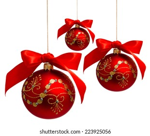 Red christmas balls with ribbon isolated on a white background