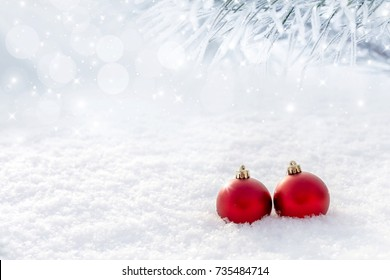 Red christmas balls in the snow. Copy and paste.