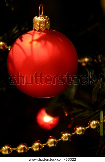 Red Christmas bauble on a tree...