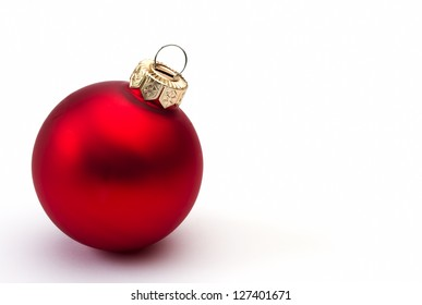 Red christmas bauble on a white background