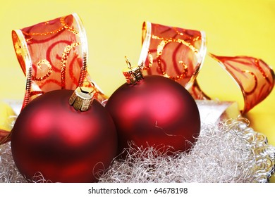 Red christmas baubles with ribbon.