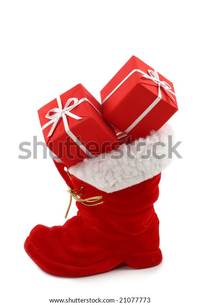 Red Christmas boot with gifts isolated on white background