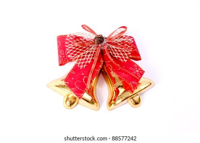 Red Christmas bow and Christmas bell on white background