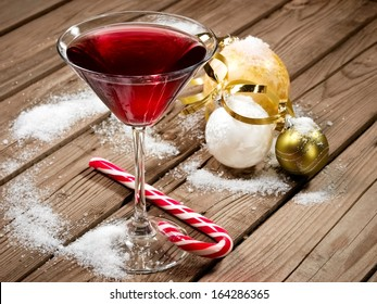 Red Christmas cocktail with balls and snow