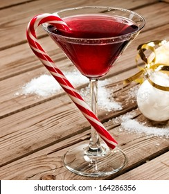 Red Christmas cocktail in martini glass