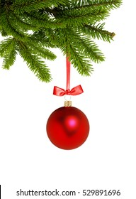 Red Christmas decor ball on green tree branch isolated on white background
