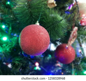 red christmas decoration on green branch
