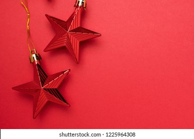 Red Christmas decoration stars. Merry Christmas and Happy New Year. Top view. Place for text
