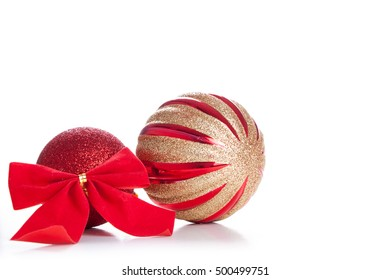 Red Christmas decorations and bow on a wooden background.
