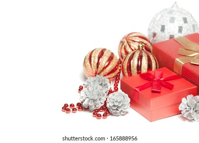 Red Christmas gift box and balls isolated on white background.
