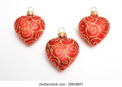 Red Christmas hearts isolated on white