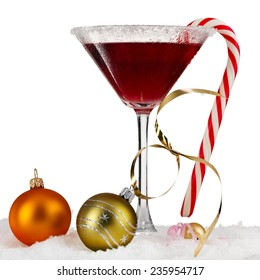 Red christmas martini with lollipop