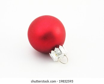 Red Christmas ornament on white background.