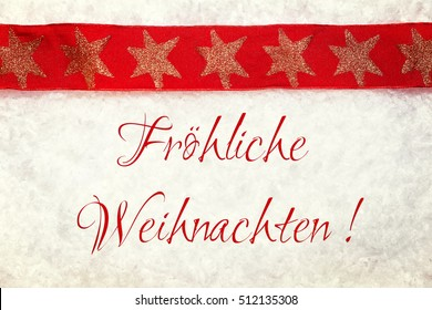 red christmas ribbon with golden stars on snowy background, with the german words froehliche weihnachten, which means happy christmas