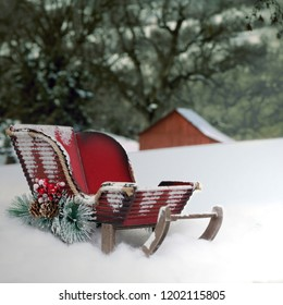 A red Christmas sleigh in the snow as a backdrop or background for portraits of pets or children.