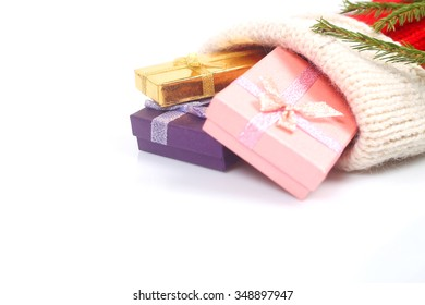 Red Christmas sock with gifts isolated on white background