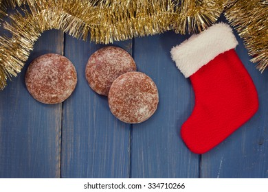 Red Christmas sock hanging on blue wooden background