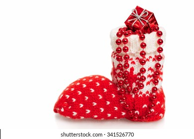 Red Christmas stocking full of presents on a white background