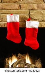 Red christmas stockings on fireplace