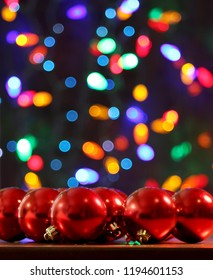 Red Christmas Tree Bulbs with Bokeh Lights Background